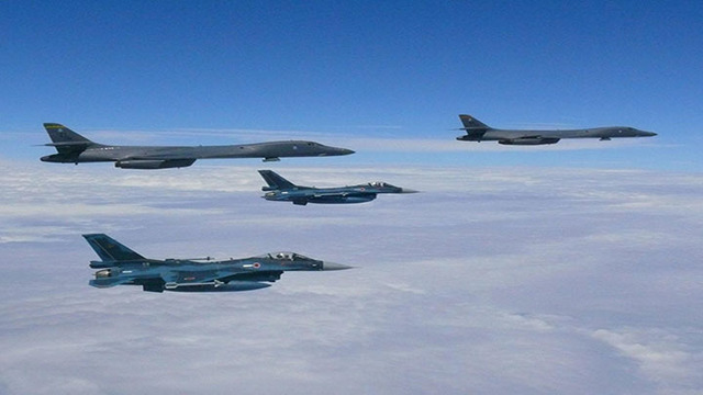 U.S.  bombers and fighter jets fly off North Korea coast