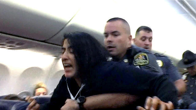 Video shows woman being forcibly removed from Southwest flight