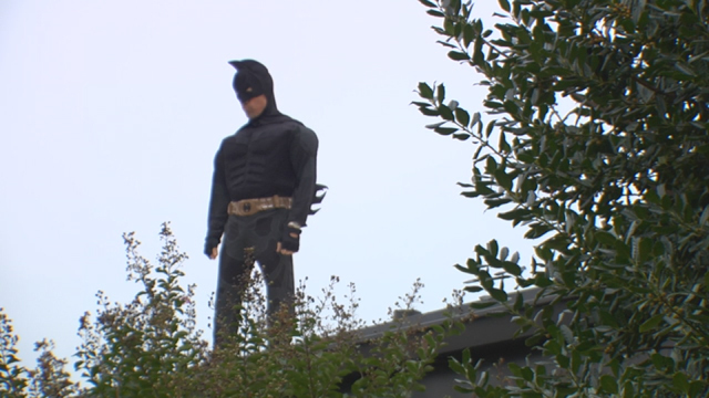 Tennessee principal sleeps on roof of school dressed as Batman